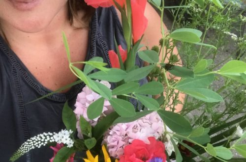 Amy Cate with a bouquet